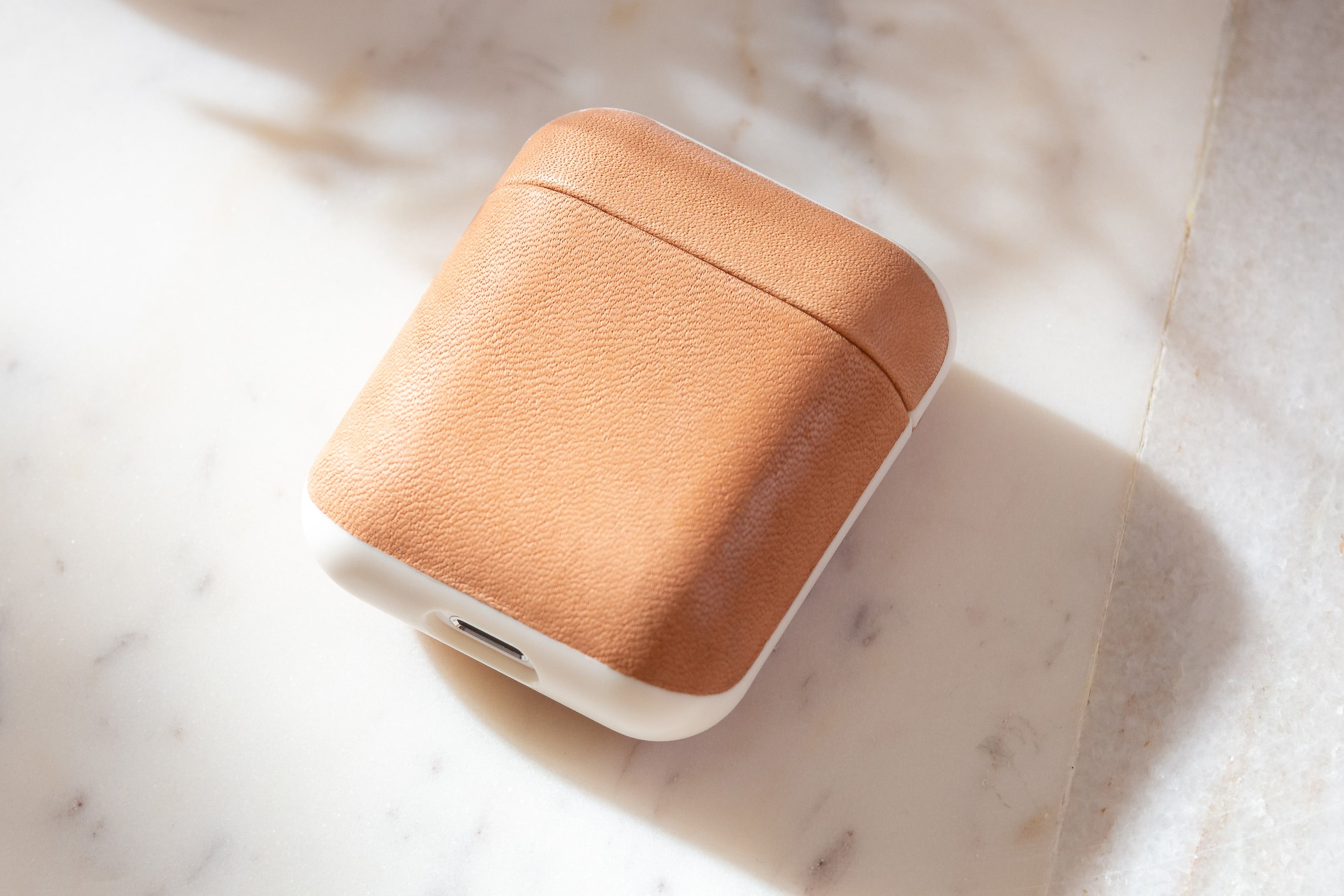 Closeup of closed Rugged Case in Natural Nude for Apple Airpods