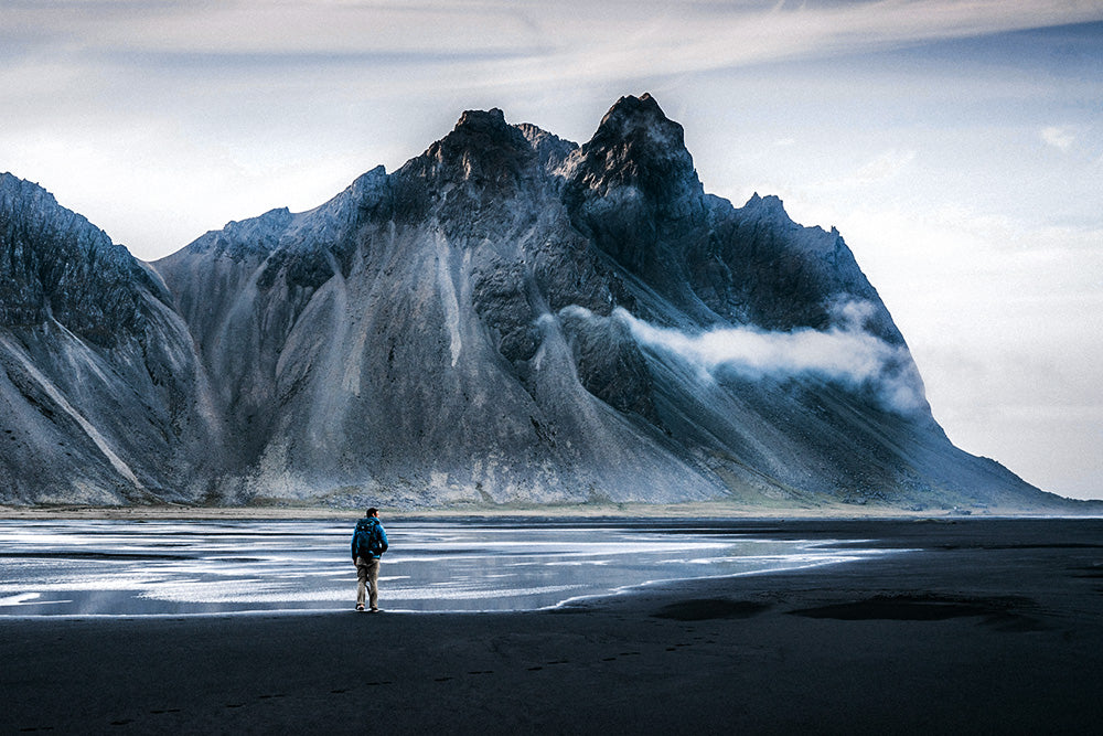 Our Story:  scenery with man in front of mountain