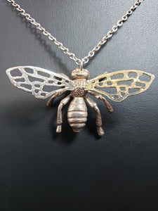 Shibuichi bee pendant with bronze wings
