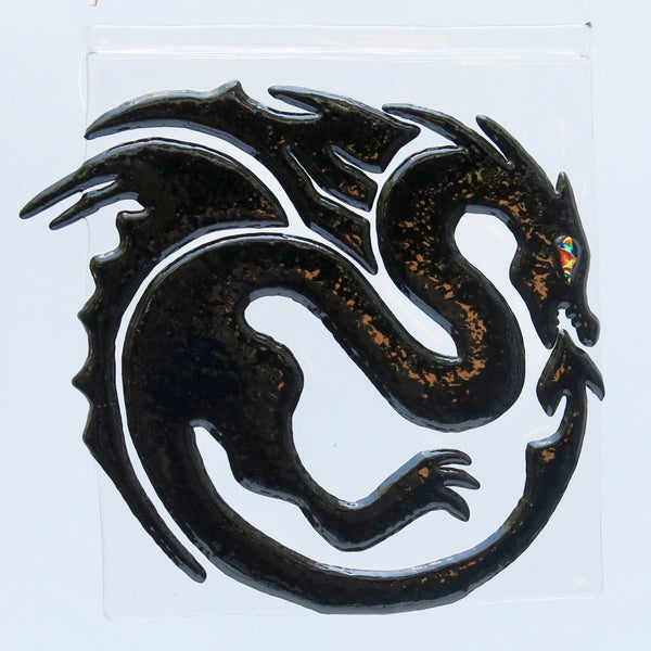 "This fused glass black dragon has a dichroic eye and measures 7"" x 7"" (18 cm x 18 cm)"