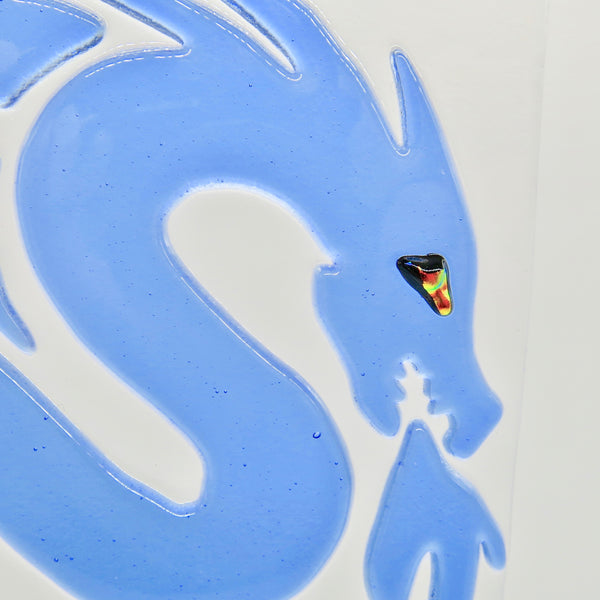"This fused glass blue dragon has a dichroic eye and measures 7"" x 7"" (18 cm x 18 cm), close up of head/eye"