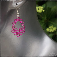 elfin alchemy colourful fuchsia pink earrings in a scroll design inspired by our ancient ancestors