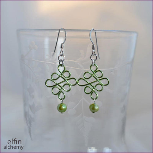 elfin alchemy light green sculptural celtic style earrings, inspired by the magical art of our ancient ancestors