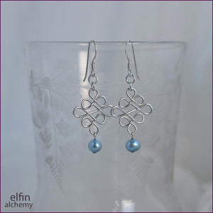elfin alchemy sculptural beaded wirework earrings inspired by the magical art of our ancestors, sterling silver and pale blue freshwater pearl bead