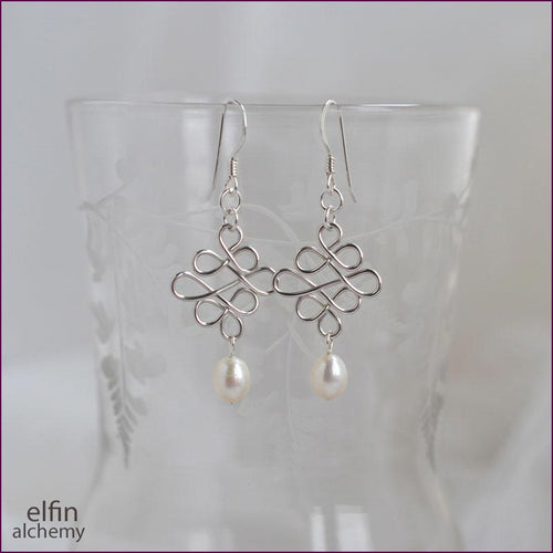 elfin alchemy sculptural beaded wirework earrings inspired by the magical art of our ancestors, sterling silver and white freshwater pearl bead