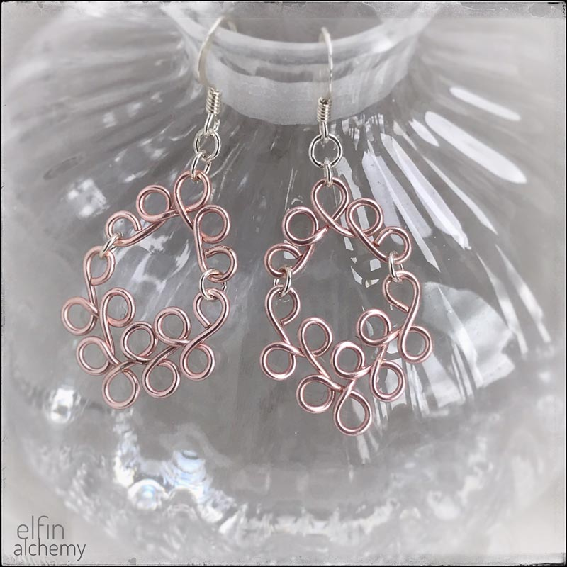 elfin alchemy blush pink sculptural scroll style earrings, inspired by the magical art of our ancient ancestors