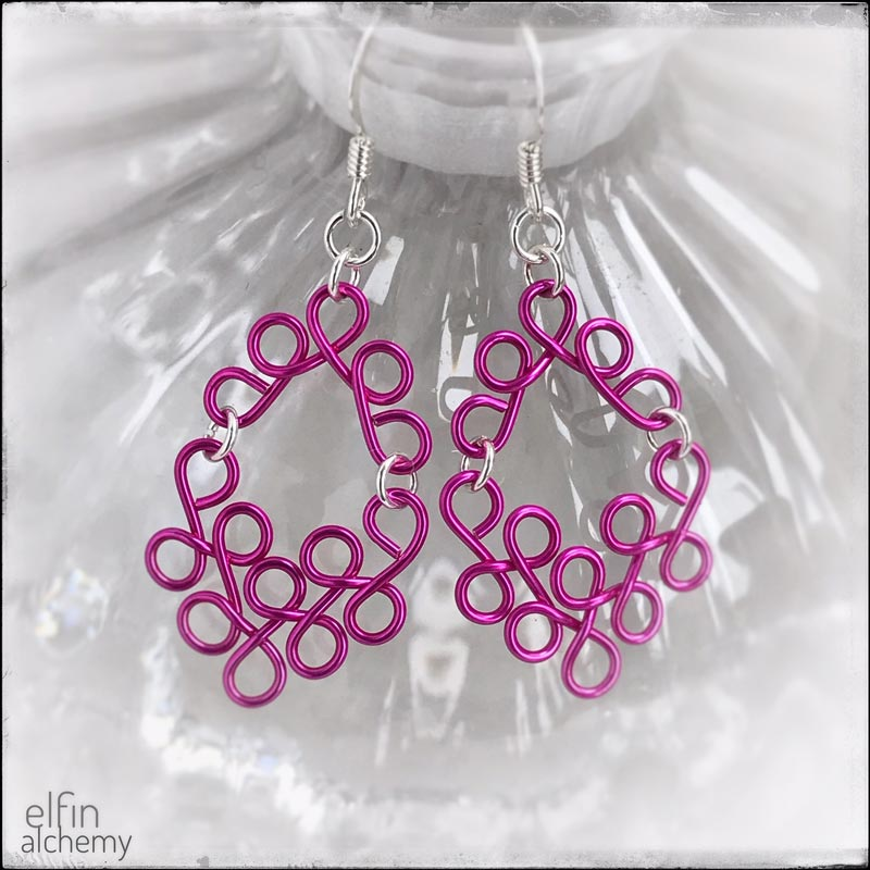 elfin alchemy sculptural scroll style earrings in fuchsia pink, inspired by the magical art of our ancient ancestors