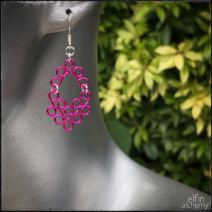 scroll style fuchsia pink earrings