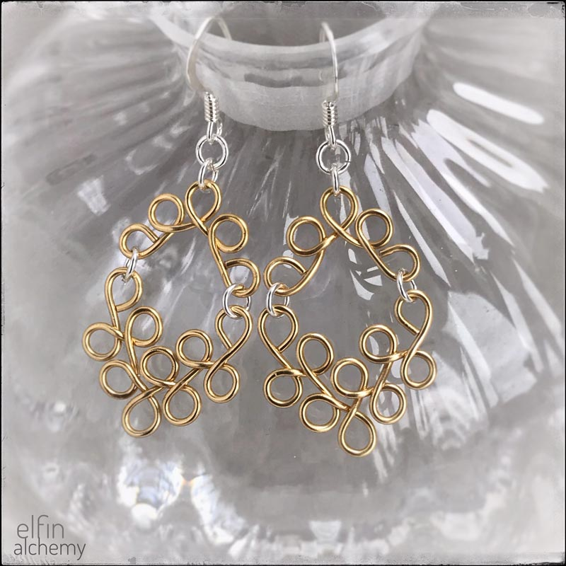 elfin alchemy gold tone sculptural scroll style earrings, magical art of our ancient ancestors