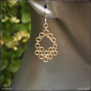 elfin alchemy sculptural scroll style earrings in gold tone, inspired by the magical art of our ancient ancestors