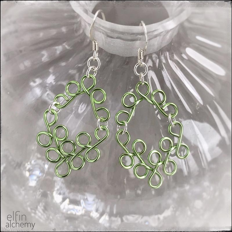 elfin alchemy pistacio green sculptural scroll style earrings, inspired by the magical art of our ancient ancestors