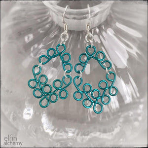 elfin alchemy turquoise sculptural scroll style earrings, inspired by the magical art of our ancient ancestors