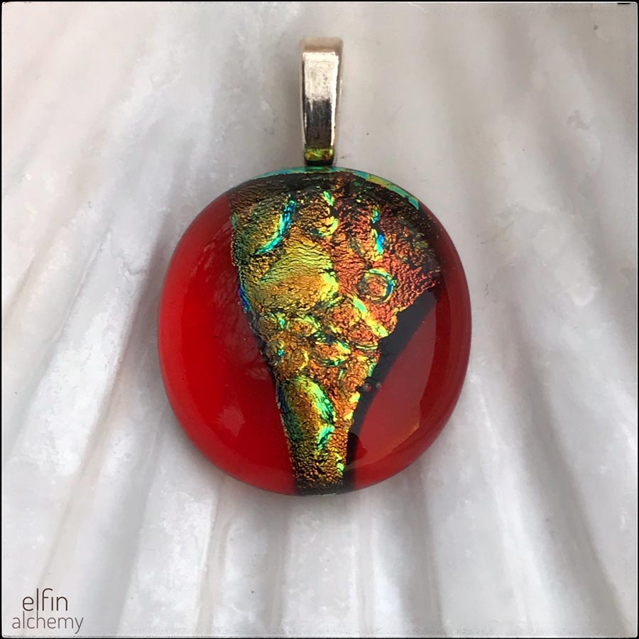 elfin alchemy zing sparkles fused glass pendant in vivid gold and bright orange tones with magical sparkle handmade in Lancashire