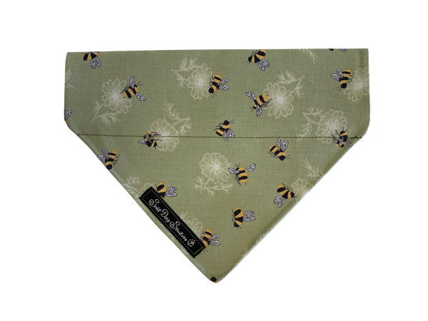 Green fabric dog bandana with little scattered bees