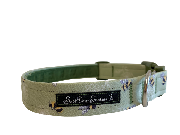 green dog collar, lined with velvet, with scattered bees on