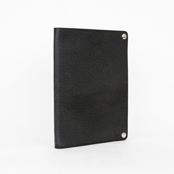 Black leather IPad case by Louis Vuitton that doubles as a stand and has openings for controls and buttons.