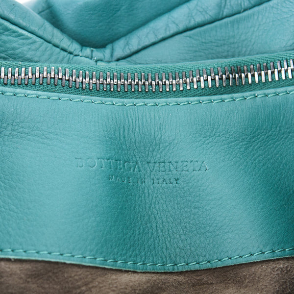 Bottega aquilone green hobo handbag with braided handle, woven center detail, and pleated sides and bottom.