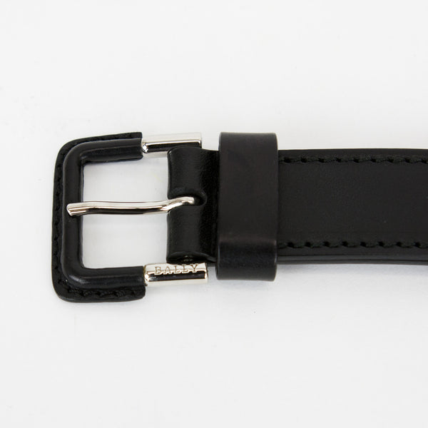 Black adjustable leather belt from Bally with a wide base, thin top, and silver tone hardware.