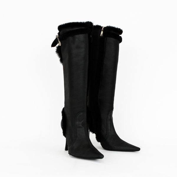 Rene Caovilla soft leather knee high boots trimmed in faux fur with rhinestone buckle at knee, side zipper, pointed toe, and covered heel.