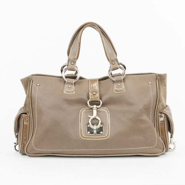 Handbag from Marc Jacobs. Light brown leather with silver tone hardware and a trigger snap closure.