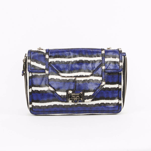 Rebecca Minkoff shoulder bag. This shoulder bag is blue, black, and white embossed leather with silver tone hardware. The front has a flap top with a flip lock closure.