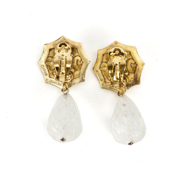 Vintage clip on earrings from Stephen Dweck with brass filigree octagon with signature beetle in center and dangling etched quartz drop.