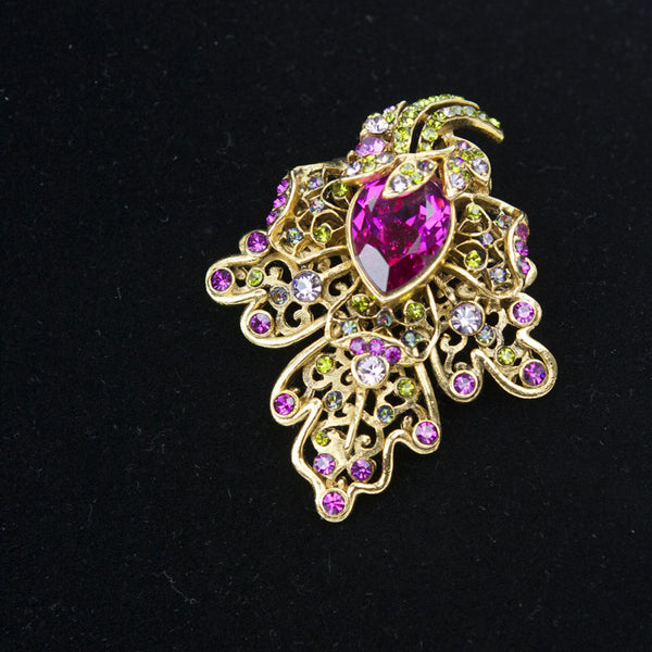 Jose & Maria Barrera pin with pink, green, blue, and purple crystals