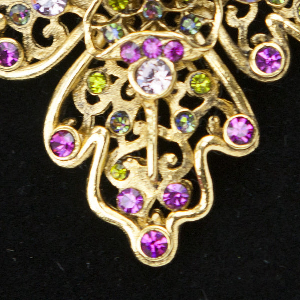 Pink, green, blue, and purple swarovski crystals on gold tone pin