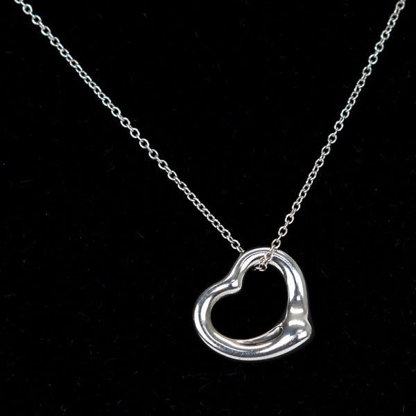 Tiffany & Co sterling silver open heart pendant necklace with spring ring clasp closure. Elsa Peretti original design.