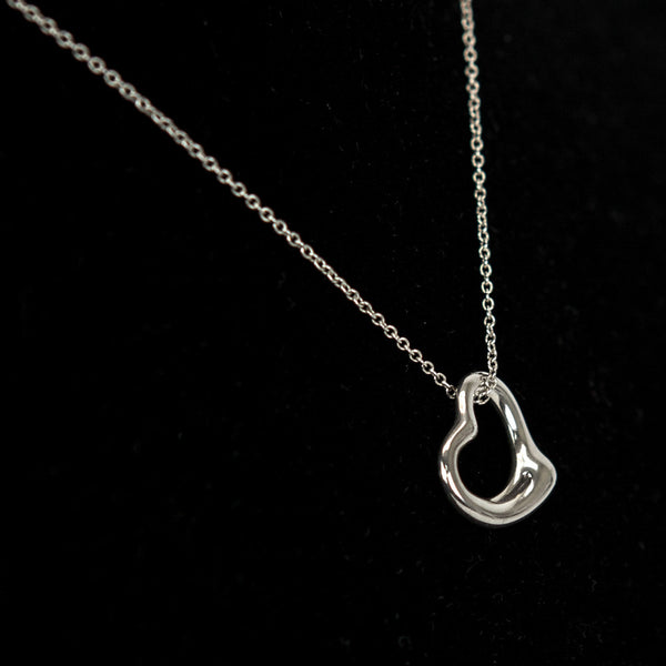 Tiffany & Co sterling silver necklace with open heart pendant with spring ring clasp closure. Elsa Peretti original design.