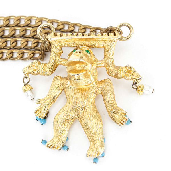 Judith Leiber vintage gold tone gorilla charm pendant with dangling faux pearls and turquoise on double brass curb chain. Chain has been replaced and not the original.