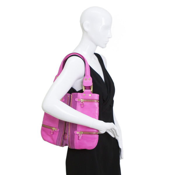 Jimmy Choo neon pink leather and suede expandable Mona tote with exterior accent zippers, gold tone hardware, and dual flat handles.