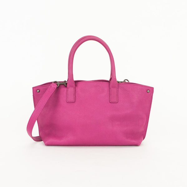 Akris pebbled leather Ai fuchsia crossbody handbag with open top and snap closure, rolled leather dual handles, and removable crossbody strap.