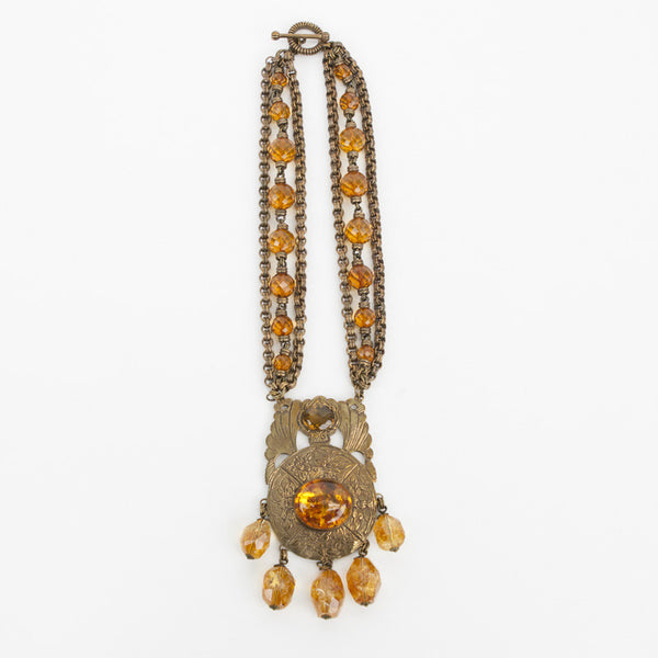Stephen Dweck brass tone necklace with faceted citrine and amber cabochon