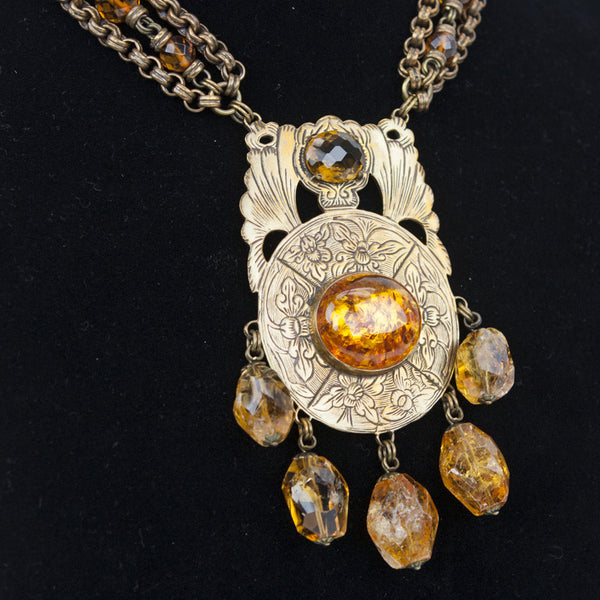 Stephen Dweck filigree pendant with amber cabochon and dangling citrine on brass tone links