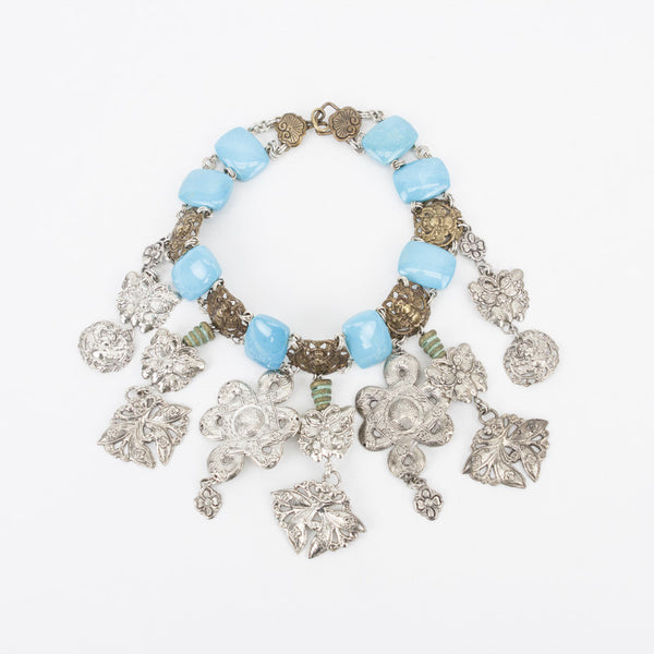 Stephen Dweck turquoise links with brass beetles and filigree silver charms
