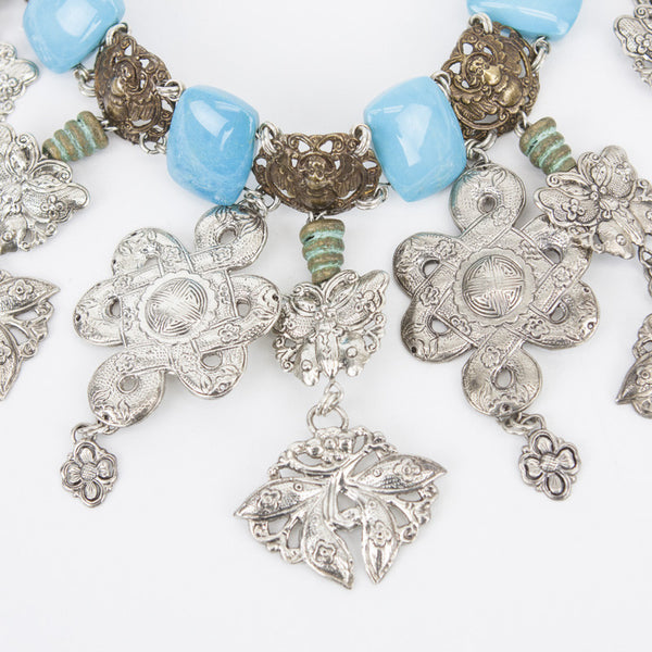 Turquoise links and brass tone beetles with silver filigree charms