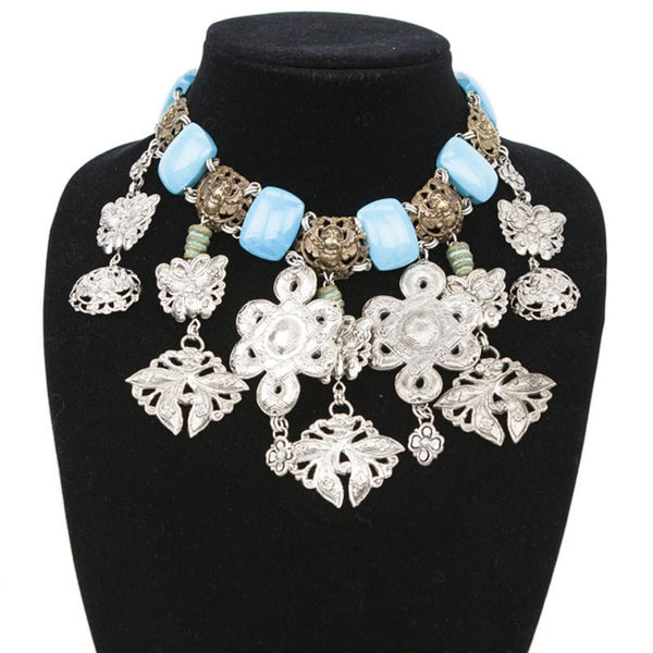 Stephen Dweck turquoise link necklace with brass tone beetles and silver filigree charms
