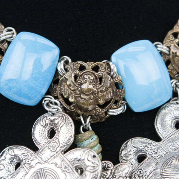 Turquoise links with brass tone beetles and silver filigree charms