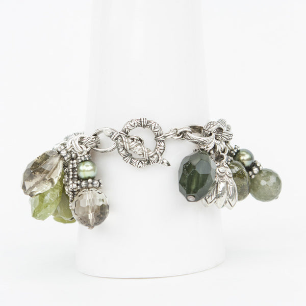 Gemstone bracelet with sterling silver charms and toggle closure