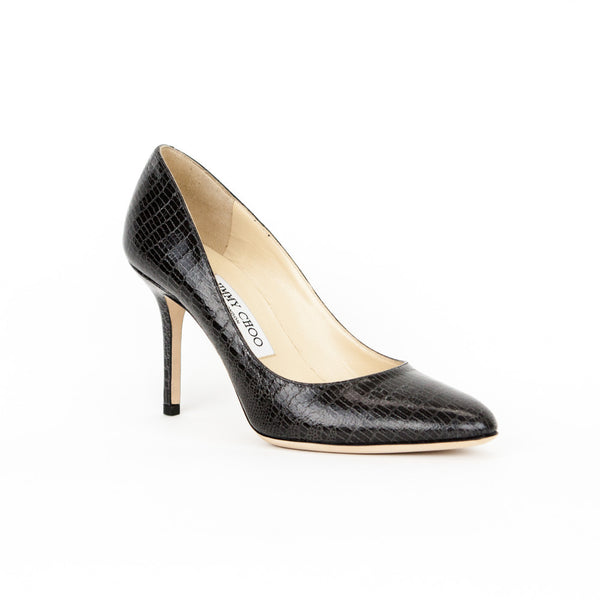 Jimmy Choo Gilbert charcoal lizard embossed leather pumps with almond toes, covered heels, and tonal stitching.