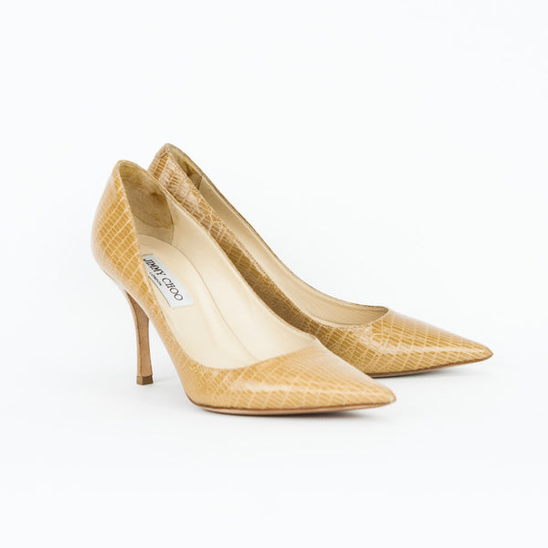 Beige Jimmy Choo lizard embossed leather heels with pointed toes and covered heels.