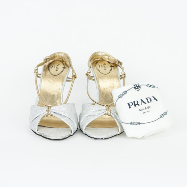 Silver & gold metallic leather heels with adjustable gold ankle strap, medium heels and leather soles.  Dust bag included.