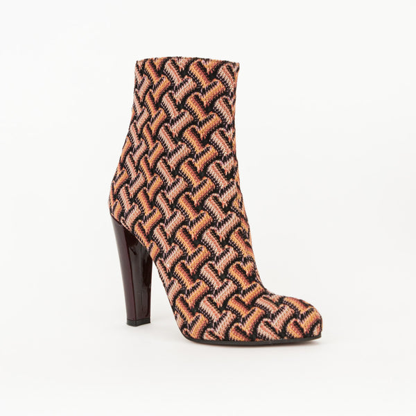 Missoni knit multi color chevron print booties with burgundy patent leather covered heels, pointed toes, and zip closures on rear.