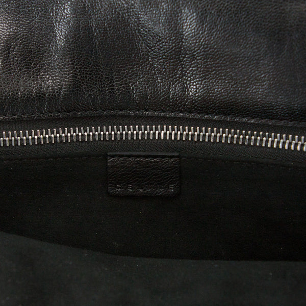 Celine black leather baguette handbag with designer tag