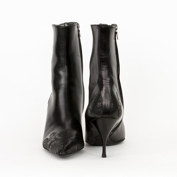 Prada black leather mid heel booties with stitched design on the heels