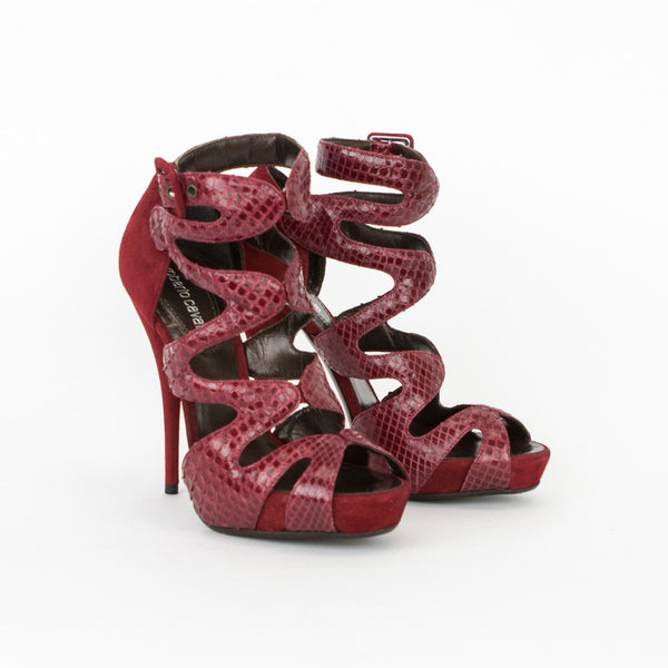 Roberto Cavalli burgundy snakeskin and suede peep toe platform heels with adjustable ankle straps, suede covered buckles closures, and covered heels.
