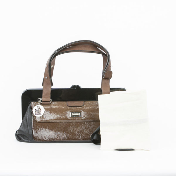 Black leather with brown patent panel with turn lock closure. Dust bag included.