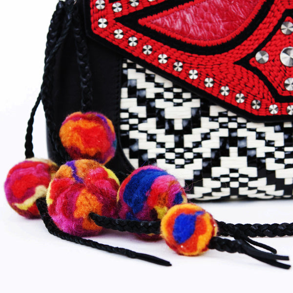 Detachable braided leather tassels with pom poms