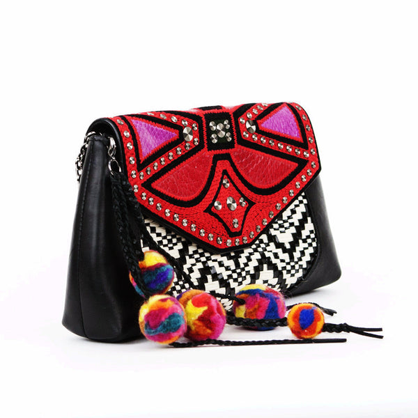 Braided leather tassels with pom poms and silver tone shoulder strap are detachable.